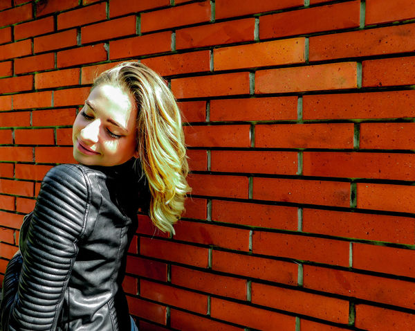 Posing in front of a brick wall Blonde EyeEmNewHere Fashion Standing Beautiful Woman Black Jacket Blond Hair Brick Wall Childhood Day Daylight Girl Lifestyles Model One Person One Young Woman Only Outdoors People Posing Real People Standing Wall - Building Feature Young Adult Young Women