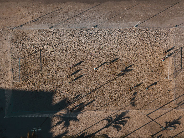 Aerial view of people playing football at beach