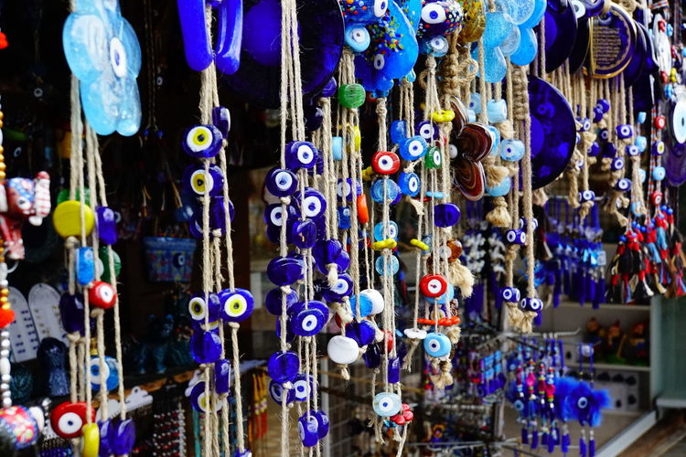 Multi colored hanging for sale at market stall