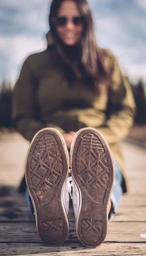 Woman relaxing on boardwalk