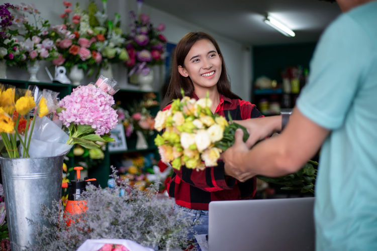 Man holding bouquet in flower shop