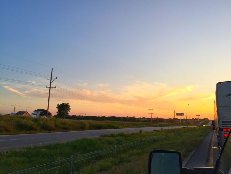 Road trip driving interstate midwest United States america summer fields clouds landscape road traveling vacation sunset sky truck motor home