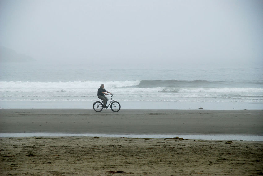 Cycling On Beach Long Beach Vancouver Island Adventure Beach Beauty In Nature Clear Sky Day Full Length Horizon Over Water Leisure Activity Man With Beard Nature One Person Outdoors Real People Sand Scenics Sea Shore Sky Sport Transportation Vacations Wave