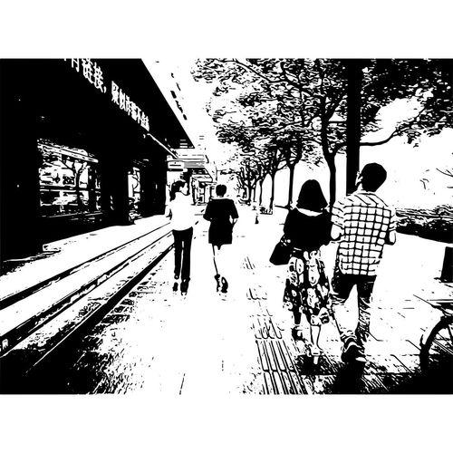 Silhouette people walking in city against sky