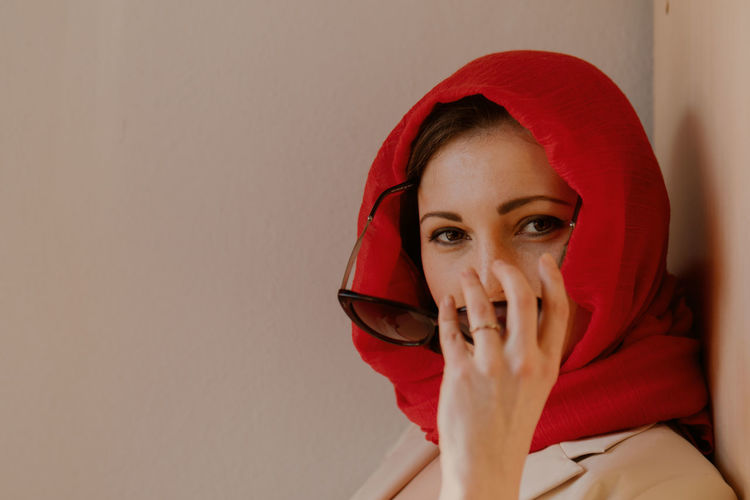 Portrait of woman covering face