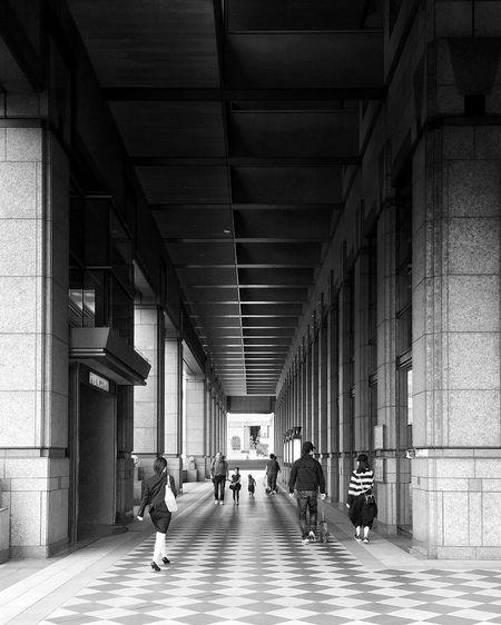 People walking on corridor of building