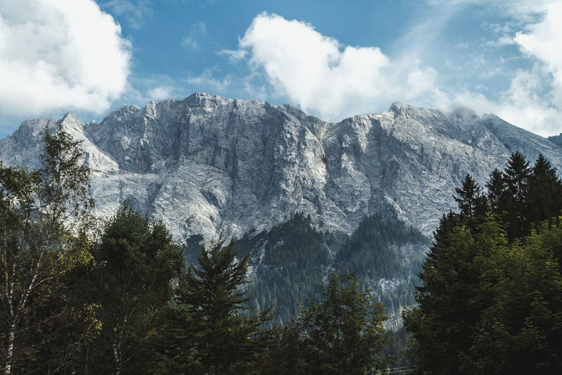 Waxenstein Adventure Beauty In Nature Clouds And Sky Majestic Mountain Mountain Peak Mountain Range Nature Outdoor Outdoors Scenics Sky Tranquil Scene Travel Traveling Tree Wanderlust Weather The Great Outdoors - 2017 EyeEm Awards