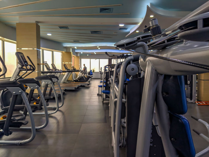 Close-up of treadmills in gym