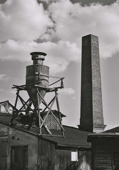 very old abandoned factory Built Structure Architecture Sky Cloud - Sky Building Exterior Low Angle View No People Day Factory Industry Smoke Stack Outdoors Water Tower - Storage Tank Chimney Storage Tank Tall - High History Fuel And Power Generation The Past Historical Building United States USA American Abandoned Michigan