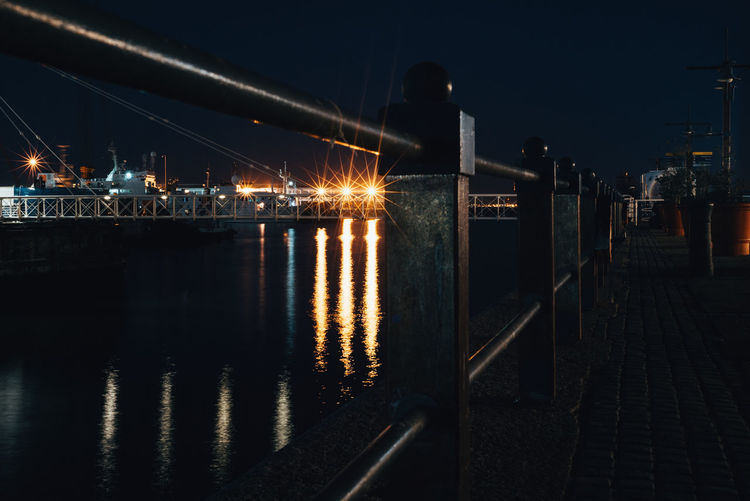 Nightphotography Architecture Building Exterior Built Structure City Connection Glowing Illuminated Light Light - Natural Phenomenon Nature Night No People Outdoors Railing Reflection River Sky Transportation Water Waterfront