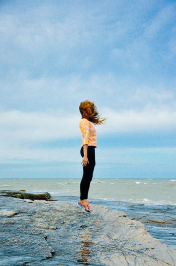 Beach Beauty In Nature Cloud - Sky Day Full Length Horizon Over Water Leisure Activity Lifestyles Nature One Person Outdoors People Real People Scenics Sea Sky Standing Water Young Adult Young Women