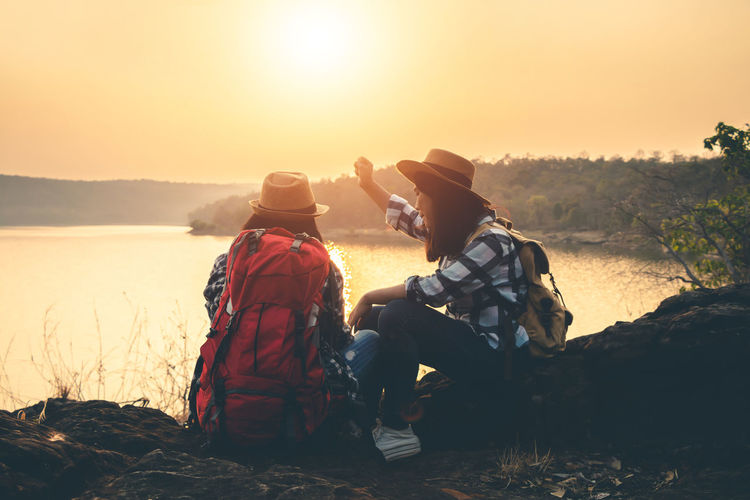 Two People Nature Sunset Sky Beauty In Nature Outdoors Landscape Travel Backpack Backpacker Women Sunlight Leisure Activity Real People Lifestyles People Tranquility Scenics - Nature Rear View Tranquil Scene Mountain Activity