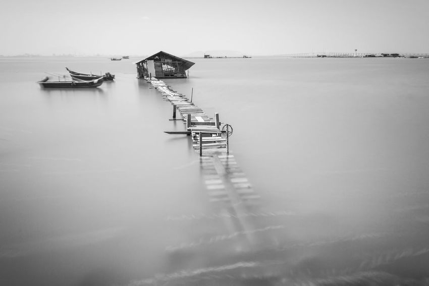 Overflow broken wooden bridge view Classic Overflow Print Architecture Beauty In Nature Blacckandwhite Black And White Bridge Built Structure Day Lake Nature Nautical Vessel No People Outdoors Scenics Sea Sky Tranquility Village Water Wooden