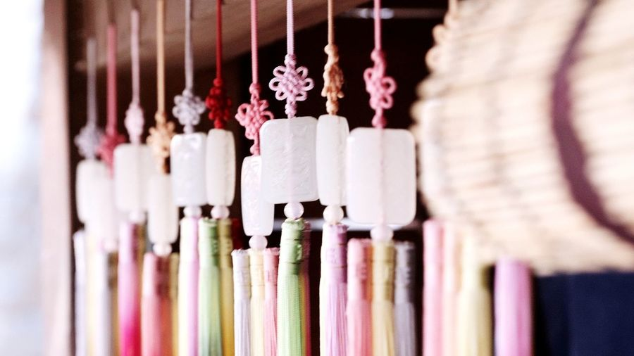 Close-up of multi colored decorations hanging in shop
