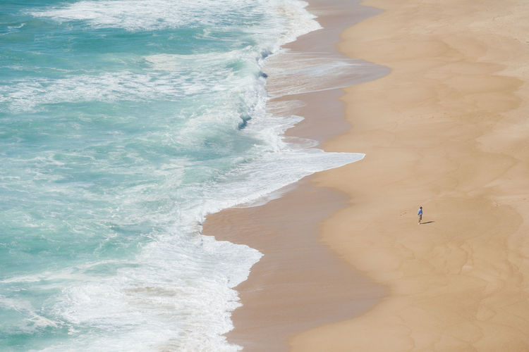 High Angle View Of Man Standing At Beach