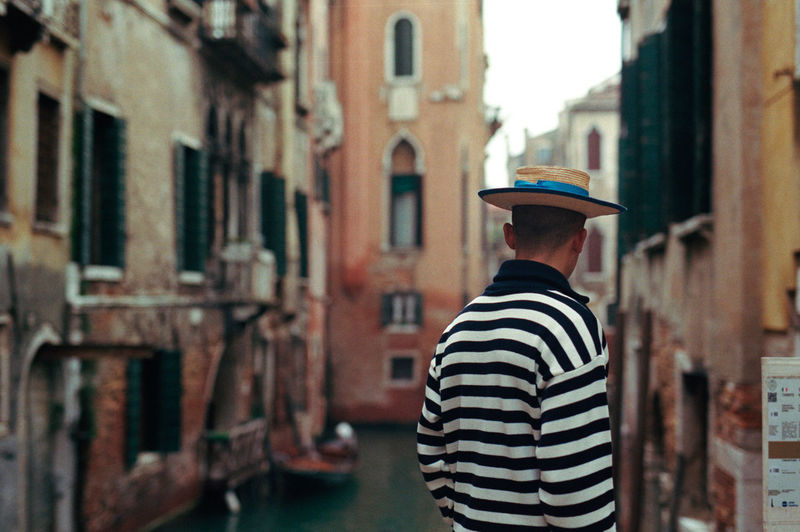 Rear view of gondolier in venice