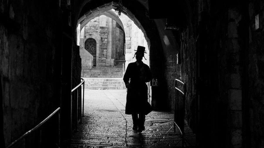 Rear view of woman walking in building