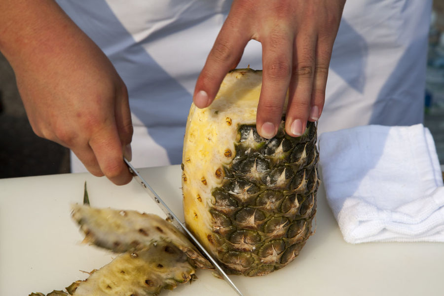cooking festival Adult Chef Chef's Whites Close-up Cooking Cuisine Cutting Board Day Food And Drink Freshness Hand Healthy Eating Horizontal Indoors  Knife Men Occupation One Man Only One Person Peeling People Person Pineapple Preparation  Preparing Food