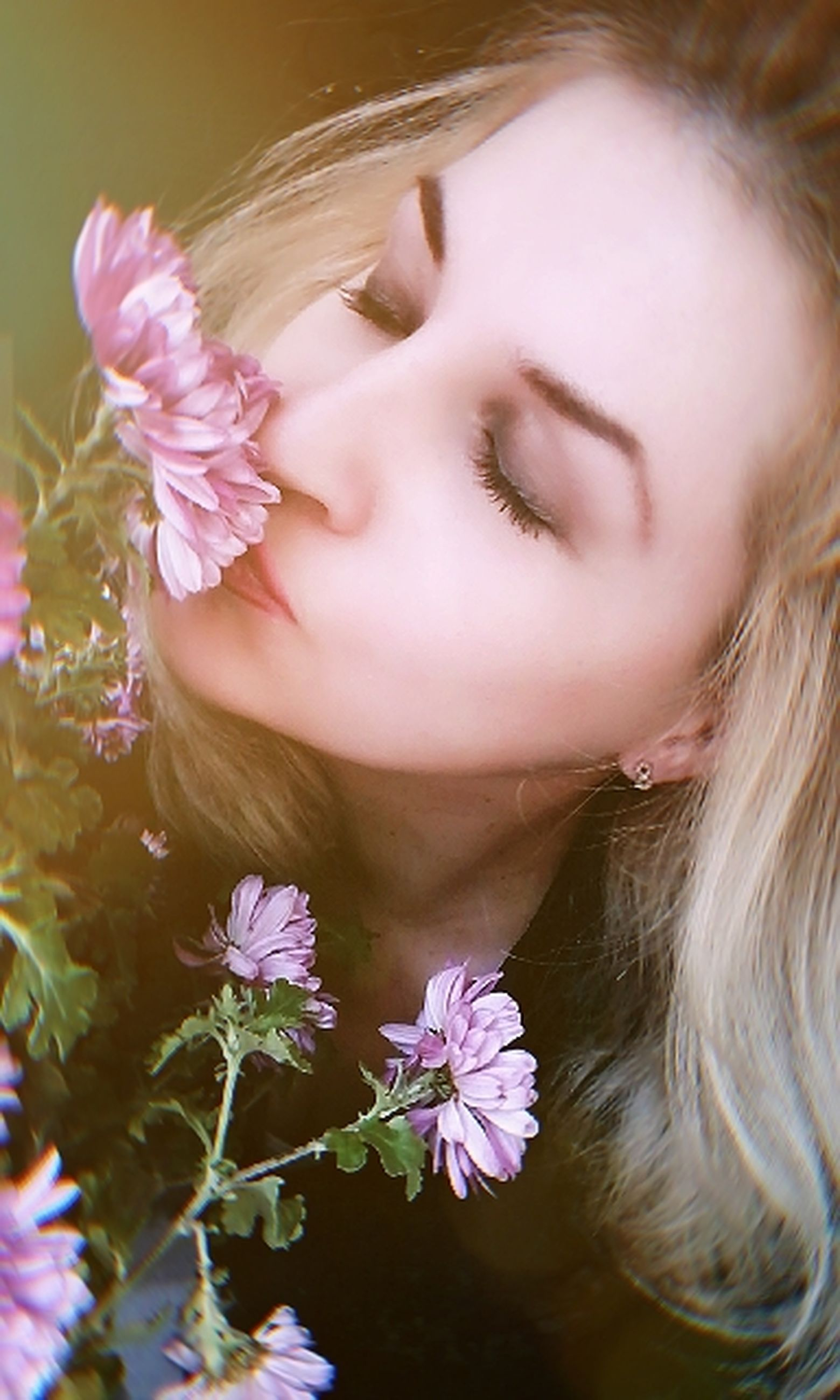 flower, flowering plant, plant, one person, headshot, real people, close-up, leisure activity, girls, lifestyles, portrait, freshness, young women, vulnerability, fragility, women, nature, child, young adult, hair, flower head, smelling, hairstyle, beautiful woman, human face
