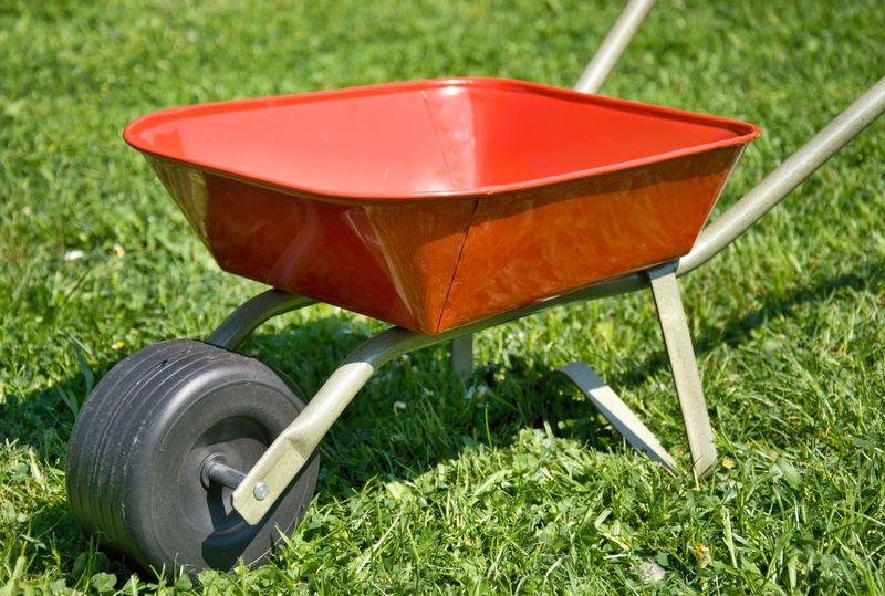 Red handbarrow Green Black Day Front Or Back Yard Grass Green Color Handbarrow Lawn No People Outdoors Red Small Toy Wheelbarrow