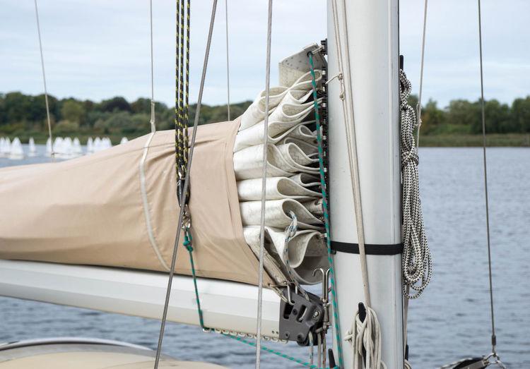 Close-up of sailboat on sea