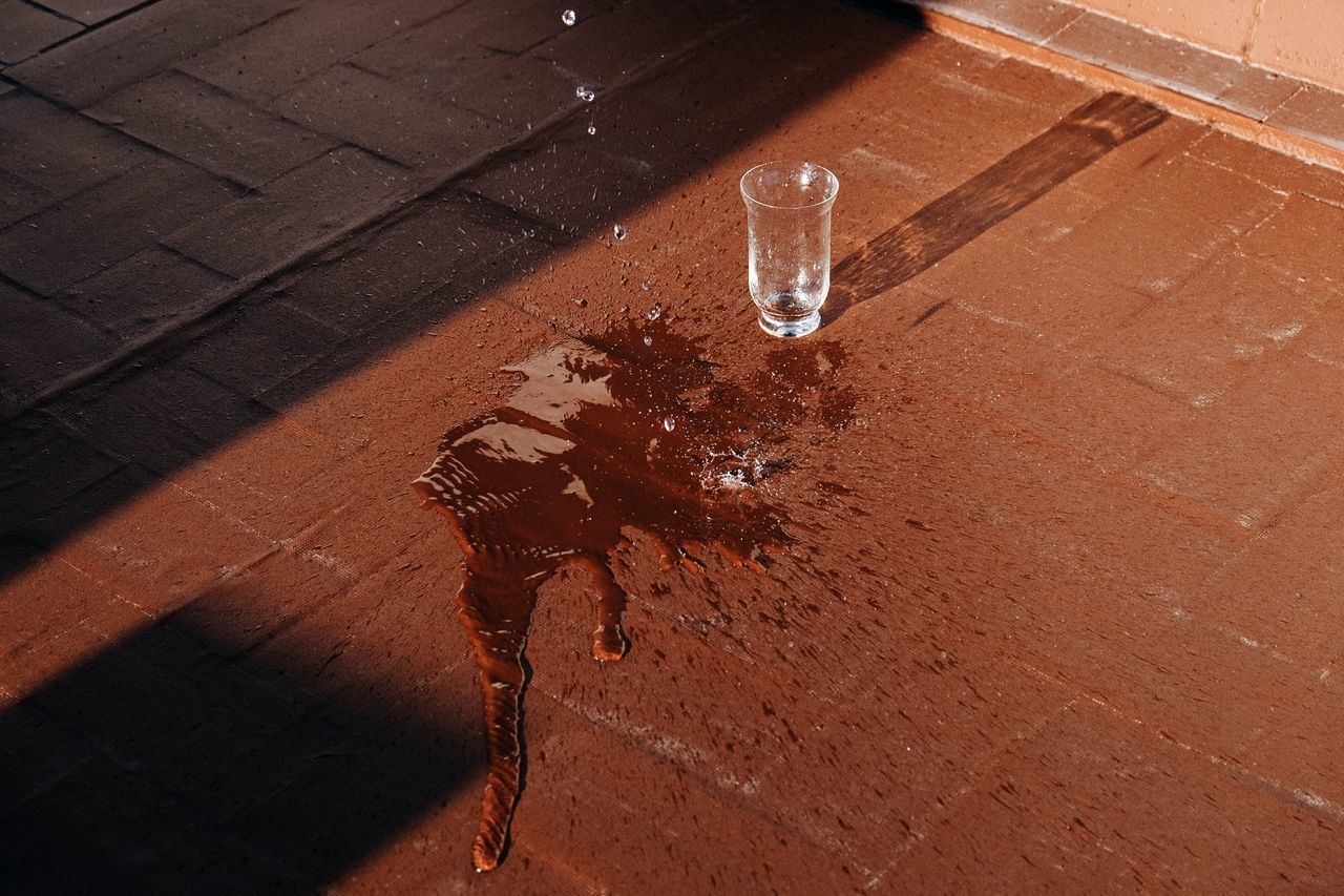 Close-up of water spilling on flooring