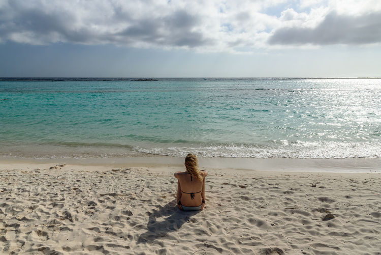 Aruba Exotic Nature Baby Beach Background Beach Caribbean Day Horizon Over Water Idyllic Leisure Activity One Person Outdoors Paradise Real People Rear View Relax Relaxation Resort Sand Summer Tropical Turquoise Water Young Women