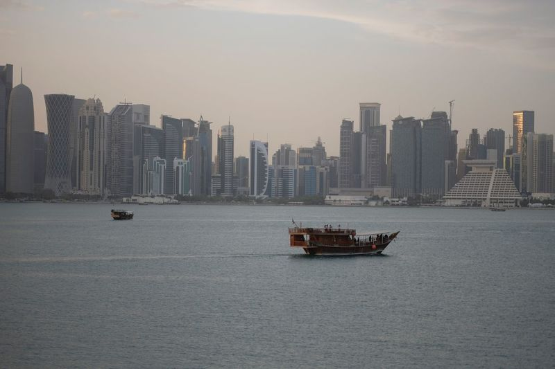 Doha skyline and dhowboat Skyline Dhowcruise Qatar Doha Qatarlife Architecture Building Exterior Water Transportation Built Structure City Nautical Vessel Skyscraper Mode Of Transportation Urban Skyline Travel Building Cityscape Sea Landscape Office Building Exterior Sky Ship Waterfront No People
