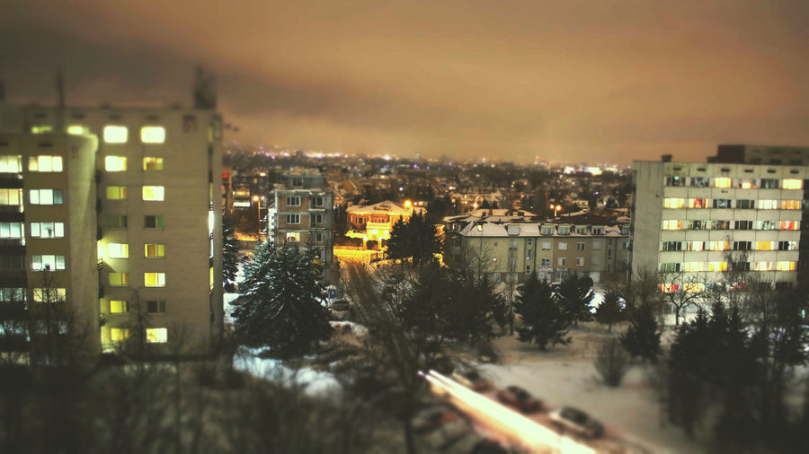 Tilt shift Orange Architecture City Cityscape Landscape Night No People Outdoors Sky Countryside Weather Condition TOWNSCAPE Urban Road Roof Snow Covered Skyscraper Rooftop Town Arid Landscape Snowcapped