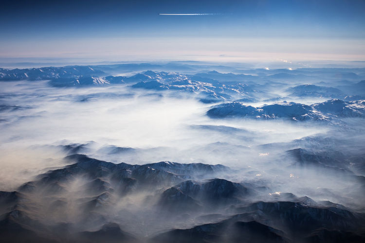 Aerial view of majestic mountains against sky