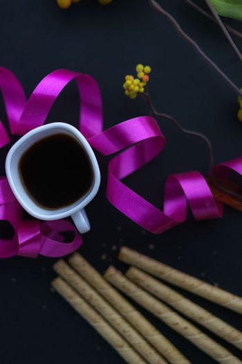Black Coffee Close-up Coffee Cup Drink Flower Freshness Indoors  No People Pink Color Refreshment Refreshments Ribbon Table Wafer Rolls Wafer Sticks Wafersticks