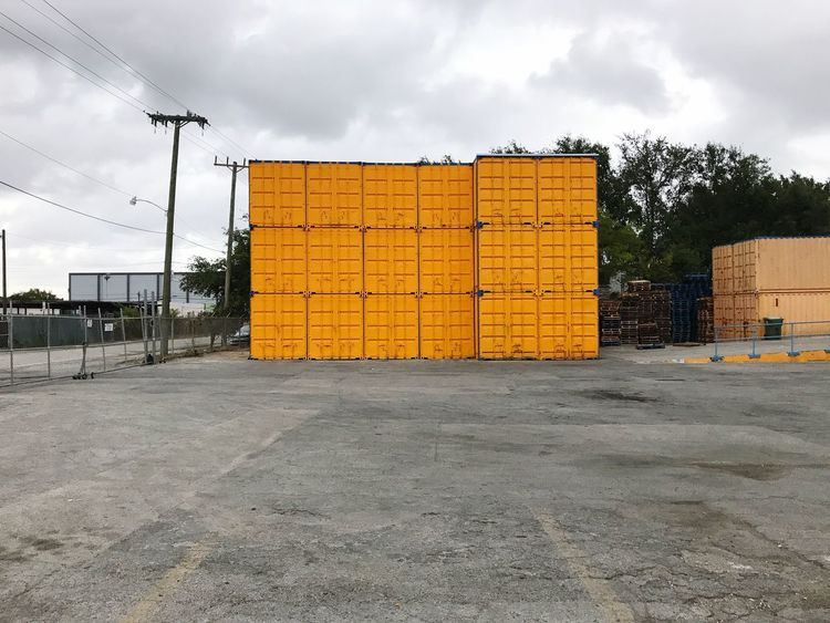 Sky Cloud - Sky Outdoors No People Day Architecture Yellow Landscape City Life Container Storage Parking Lot City