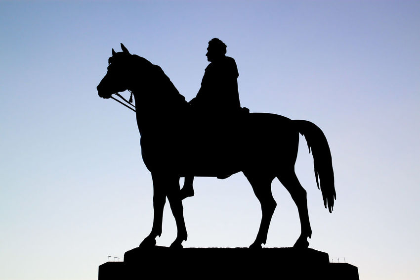King George IV statue in silhouette. Trafalgar Square, London. King George IV London Silhouette Statue United Kingdom Animal Themes Black Clear Sky Day Domestic Animals Full Length Horse Horseback Riding Low Angle View Mammal Monument No People One Animal Outdoors Riding Sculpture Silhouette Sky Statue Trafalgar Square