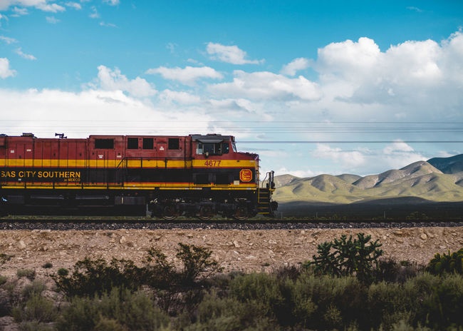 Beauty In Nature Blue Cable Cloud Cloud - Sky Day Desert Journey Landscape Mode Of Transport Mountain Nature No People Outdoors Power Line  Public Transportation Railroad Track Scenics Sky Speed Train Tranquil Scene Travel Travel Photography