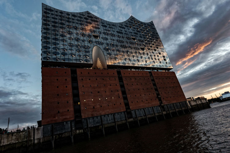 Elbphilharmony Dramatic Sky Hafencity Hamburg Hamburg Harbour Jacques Herzog, Pierre De Meuron Modern Architecture Architecture Building Exterior Built Structure City Cloud - Sky Day Elbphilharmony Low Angle View Modern Nature No People Outdoors Sea Sky Skyscraper Sunset Travel Destinations Water