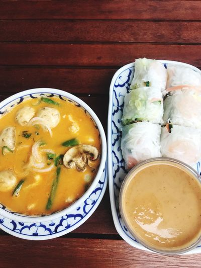 Flat lay of Vietnamese food Summer Roles Tom Kha Gai Soup Vietnamese Food Food And Drink Food Freshness Table Healthy Eating Still Life Wellbeing Directly Above No People High Angle View Plate Soup Meal Indoors  Temptation