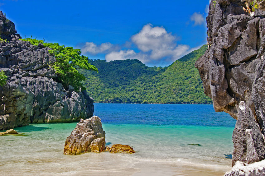 Beach In Caramoan Bicol, Philippines Camarines Sur, Philippines CaramoanIslands Beach Beauty In Nature Bicol Blue Cloud - Sky Day Mountain Nature No People Outdoors Rock - Object Rock Formation Scenics Sea Sky Tranquility Tree Water EyeEm Ready
