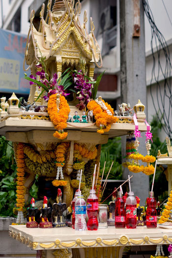 Colorful spirit house in Bangkok city, Thailand ASIA Asian  Bangkok City Spirit House Thailand Tradition Art And Craft Buddhism Culture Floral Garland Flower Joss House Offering Photography Place Of Worship Religion Representation Statue Temple Travel Destinations