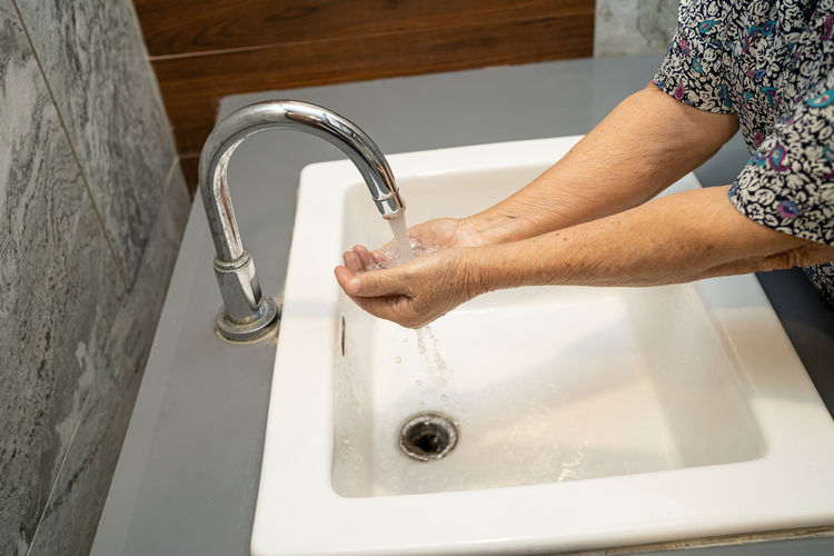 High angle view of woman hand in bathroom