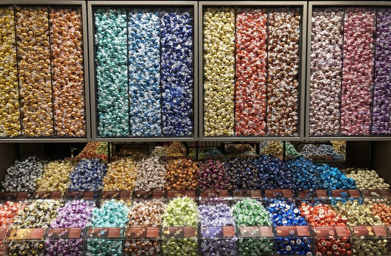 colourful sweets Choice Variation Large Group Of Objects Abundance Multi Colored Indoors  No People Sweets Colourful Retail  Food And Drink Food Arrangement For Sale Store In A Row Order Freshness Sweet Food Container Business Full Frame Retail Display Consumerism Display Cabinet