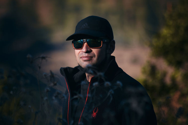 Portrait of young man wearing sunglasses standing outdoors