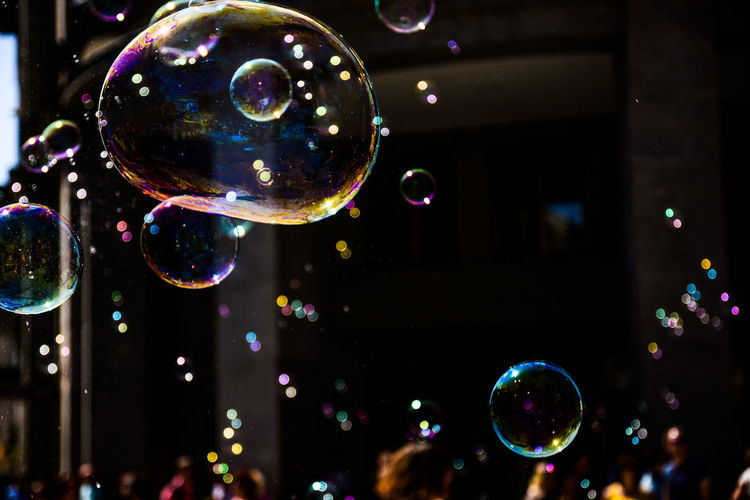 Bubble Bubble Wand Circle Close-up Focus On Foreground Fragility Geometric Shape Illuminated Lightweight Mid-air Multi Colored Nature No People Outdoors Reflection Shape Shiny Soap Sud Sphere Transparent Vulnerability
