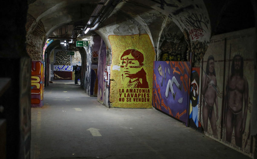 Graffiti Art And Craft Architecture Creativity Indoors  Illuminated Tunnel Wall - Building Feature Built Structure No People Text The Way Forward Human Representation Representation Transportation Multi Colored Lighting Equipment Street Art Mural