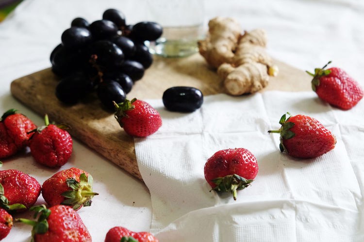 Close-up of strawberries on tablecloth
