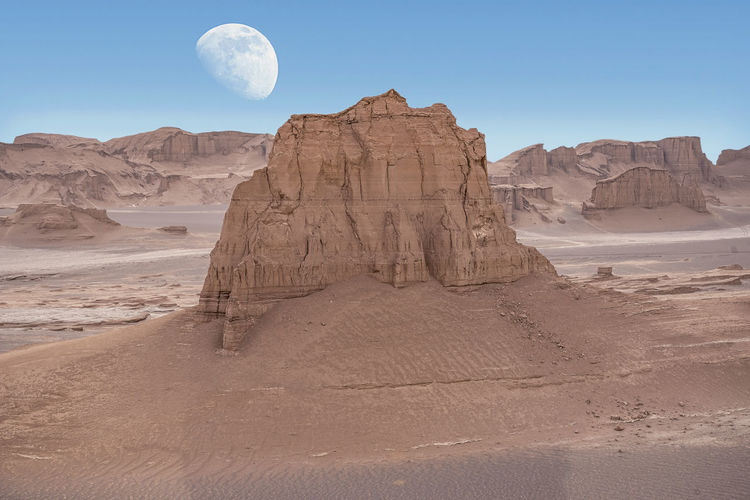 View of rock formation in desert against sky