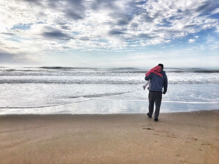 Father And Daughter Fatherhood Moments Father Beach Sea Land Sky Water Beauty In Nature Real People Full Length Cloud - Sky Horizon Horizon Over Water Scenics - Nature Nature Leisure Activity Lifestyles Rear View Sand Outdoors Standing A New Beginning