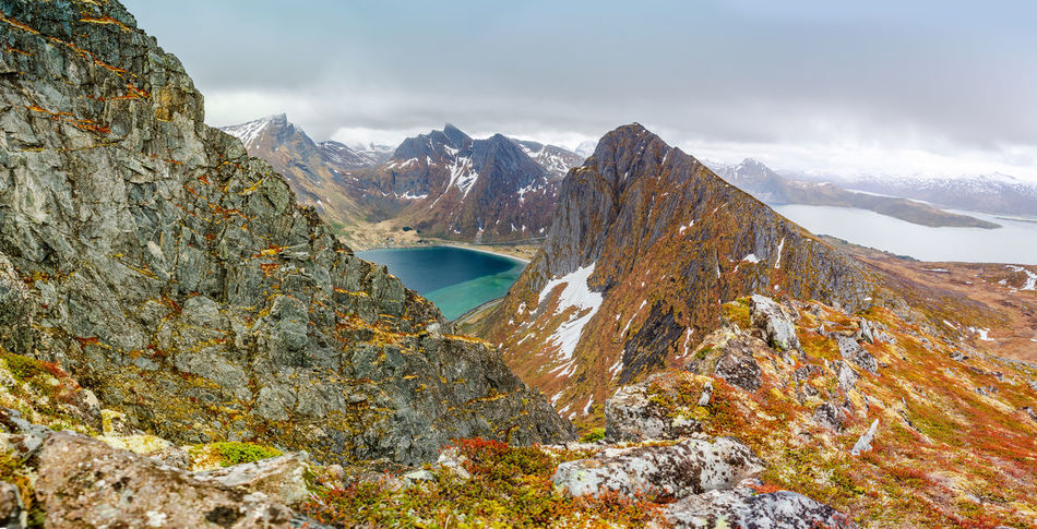 landscape view of Senja Island in Norway Barents Sea, Northern, Senja Island, Arctic, Atlantic, Coast, Cold, Europe, Fishing, Fjord, Harbor, Holiday, Ice, Landscape, Mountains, Nature, Nordic, North, North Sea, Norway, Norwegian, Ocean, Outdoor, Polar Circle, Port, Scandinavia, Sea, Seascape, Sky, Spring, Summer, Tourism, Travel, Village, Water Mountain Water Beauty In Nature Scenics - Nature Mountain Range Tranquil Scene Tranquility Sky Cloud - Sky Nature Non-urban Scene Winter Rock Day Cold Temperature Snow Environment Lake No People Outdoors Snowcapped Mountain Mountain Peak Formation Flowing Water