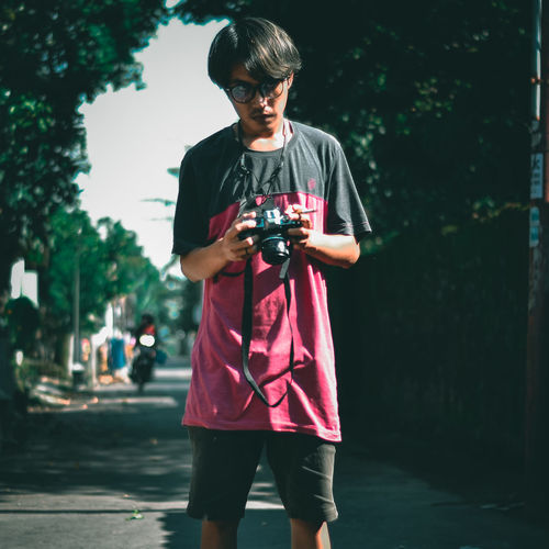 Young street phothograper