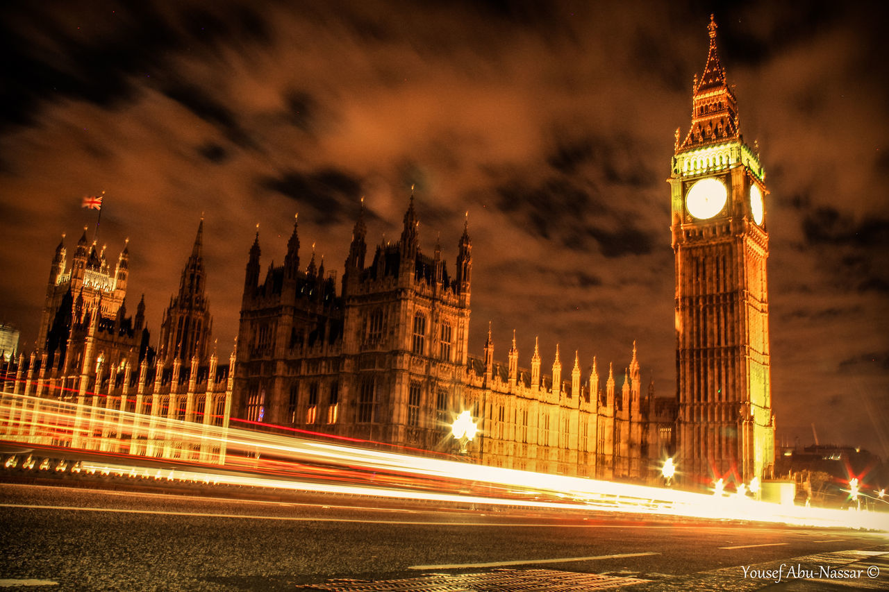 illuminated, long exposure, architecture, blurred motion, night, motion, speed, light trail, building exterior, clock tower, built structure, travel destinations, city, outdoors, sky, no people