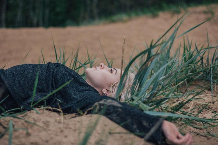 Portrait of boy lying on land